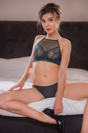 Sweet model invites to visit her cozy bedroom and surprises with hot strip