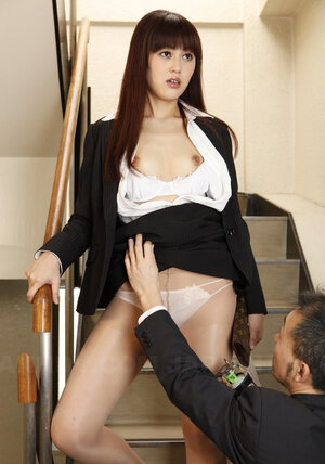 Dude in a suit takes off Asian's nylons on the stairs and aims strange dong at it