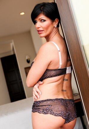 Brunette dame with short hair looks so seductive wearing this lingerie