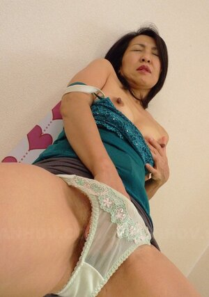 During sex party Japanese Soccer mom finds quiet spot to finger own shaggy peach