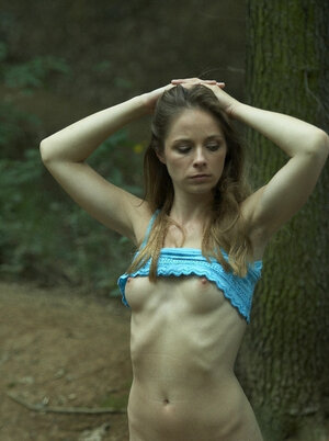 Hoe with sticking out ribs is pinioned up to a tree by pervert in the forest