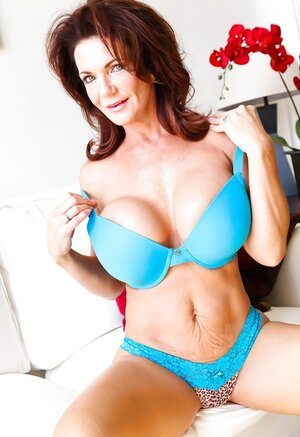 Grown-up goddess poses in blue underwear that accentuates her amazing assets