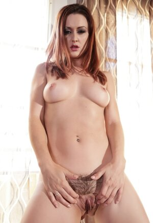 Staggering redhead Karlie Montana is in mood to touch trimmed honey pot in corridor