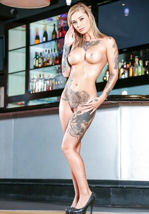 Inked performer and pornstar takes off cocktail dress and underwear in the bar