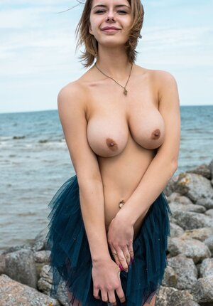 European kitten begins with natural tits and moreover then goes to cum bucket on the stony beach