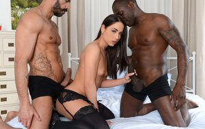 Gal looks into the camera being double penetrated by black and white boys