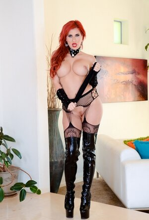 Ravishing Soccer mom with red hair and moreover juicy tits poses on cam dressed in latex boots