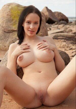 Slutty thin girl likes empty beach and furthermore strips to get round twins tanned