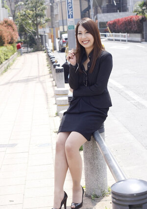 Japanese business dame decides to make some sexy photos for social networks