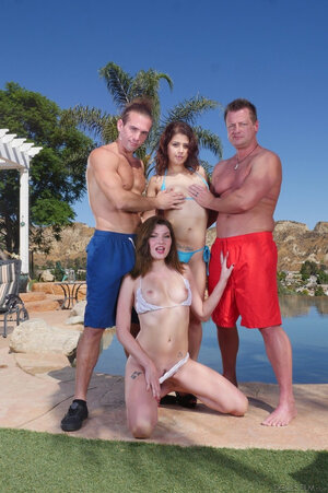 Lovely gal and her underweight friend pose with a couple of athletic lads by the pool