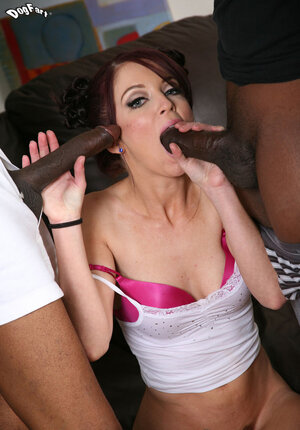 Redhead with a pair of bows in her hair is banged and facialized by a pair of black pals