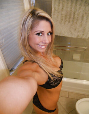 With a smile lascivious blonde drops down lace underwear whilst making selfies