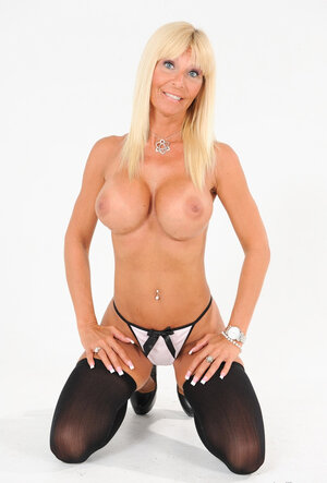 Full-bosomed blonde with blue eyes is a Mom i`d like to get down and dirty who many guys would like to get down and dirty